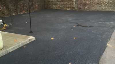 New Tarmac Driveway Behind a Building
