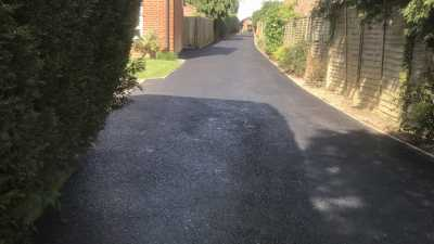 Long Tarmac Driveway for a Housing Development